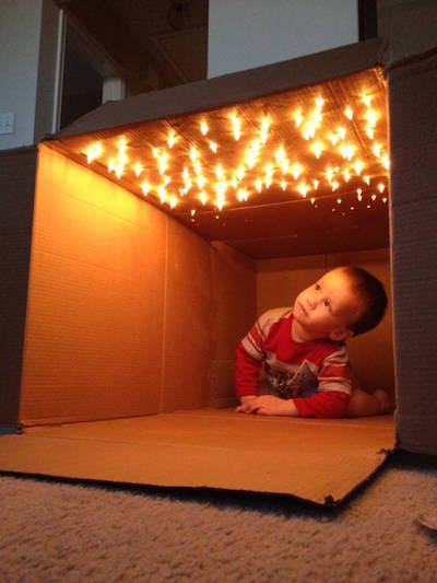 Star fort made out of cardboard box and string lights