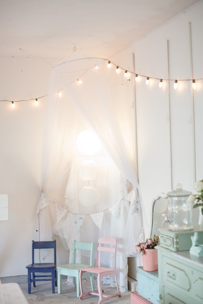 Nursery decorated with string lights
