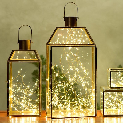 Glass lanterns with fairy lights inside